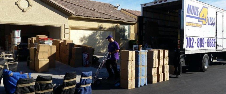 move a4 less mover at work in driveway of home loading boxes on moving van