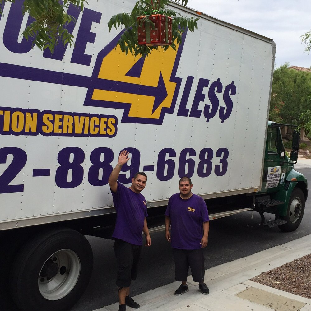 Two happy Move 4 Less movers waving in front of their door to door moving truck