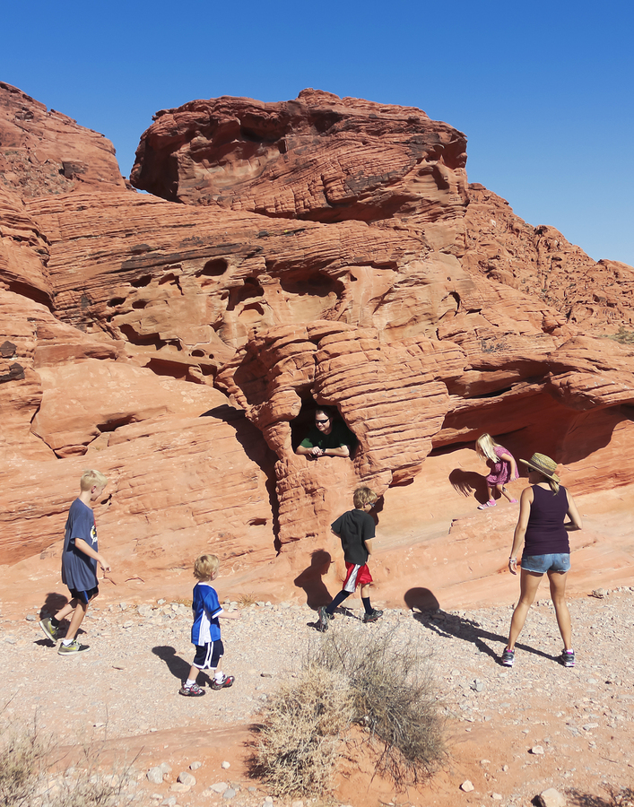 A Family Hiking At The Valley Of Fire State Park
