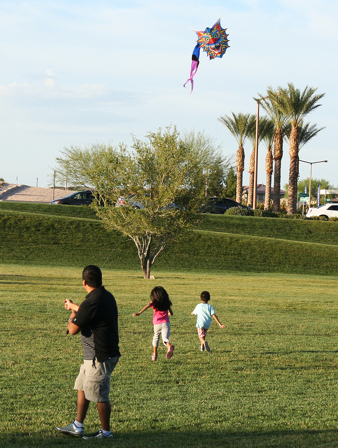 Summerlin family of three flying kite in a Summerlin, Las Vegas, NV park