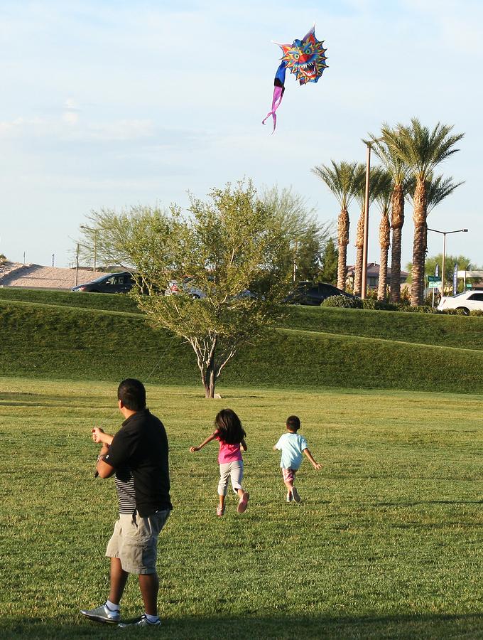 Summerlin family of three flying kite in a Summerlin, Las Vegas, NV park