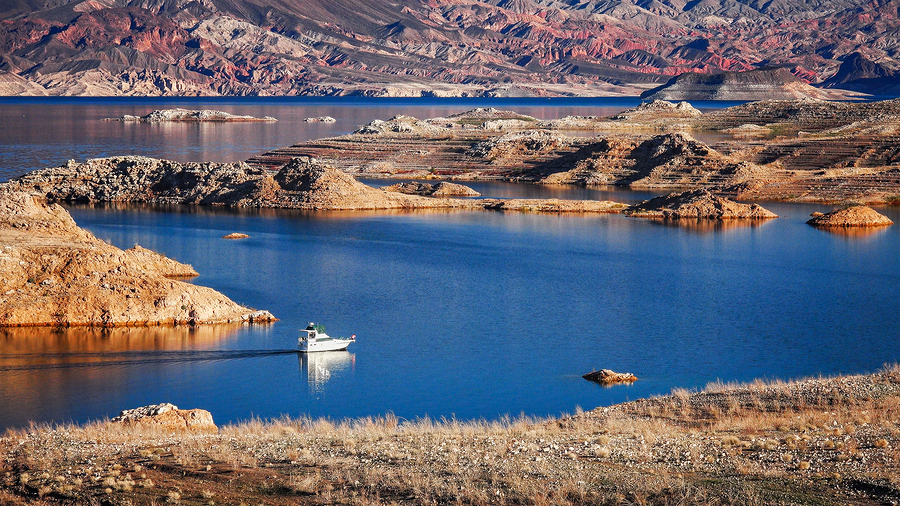 A boat enters a narrow channel on Lake Mead