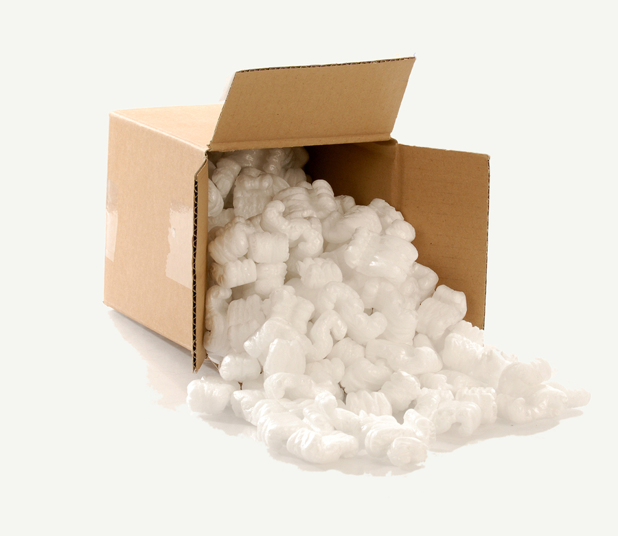 Cardboard moving box filled with polystyrene or natural cornstarch foam chips