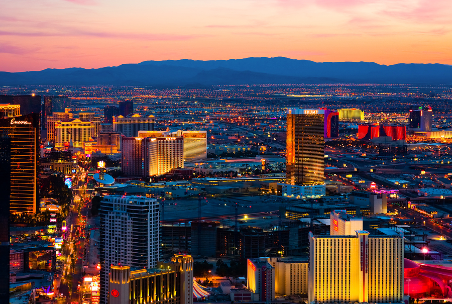 An aerial view of the Las Vegas Strip and surroundign Las Vegas Valley at sunset
