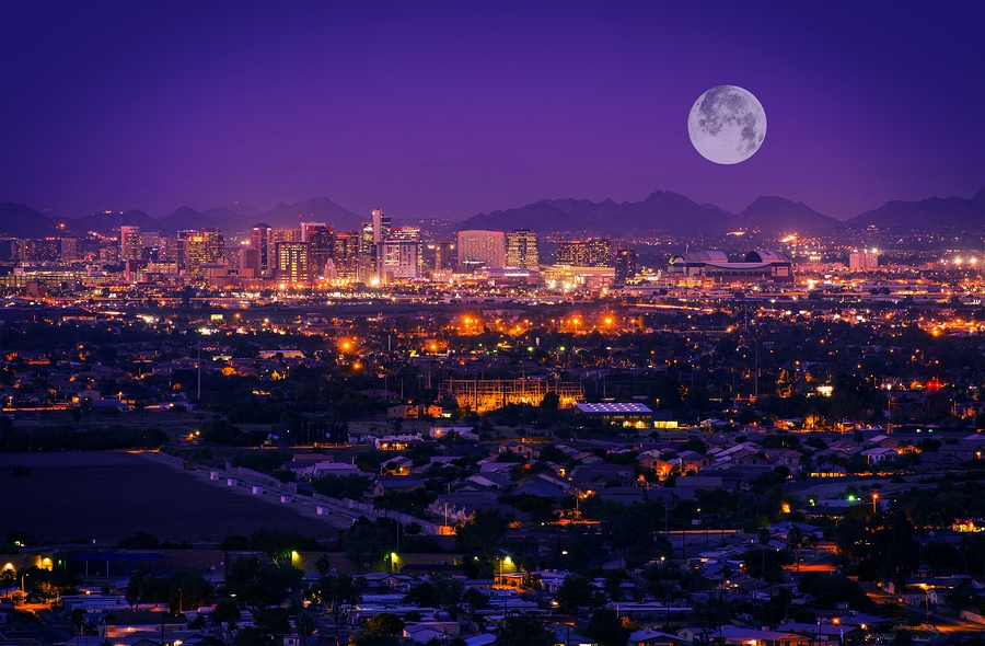 Phoenix AZ skyline at night with full moon