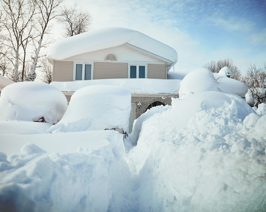 House blocked by snow in winter