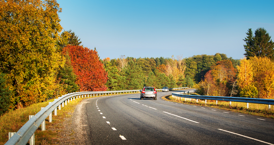 cars moving on a highway road in autumnal landscape