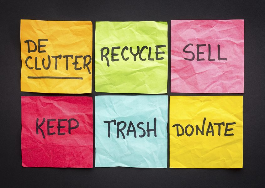 declutter (keep, recycle, trash, sell, donate - handwriting on color sticky notes