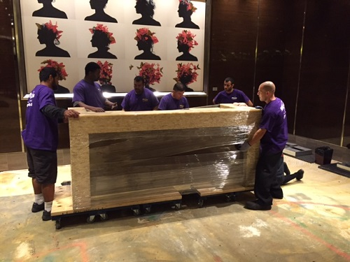 Move 4 Less team places large fixture on wooden dolly for transportation at the Cosmopolitan Hotel and Casino Resort in Las Vegas