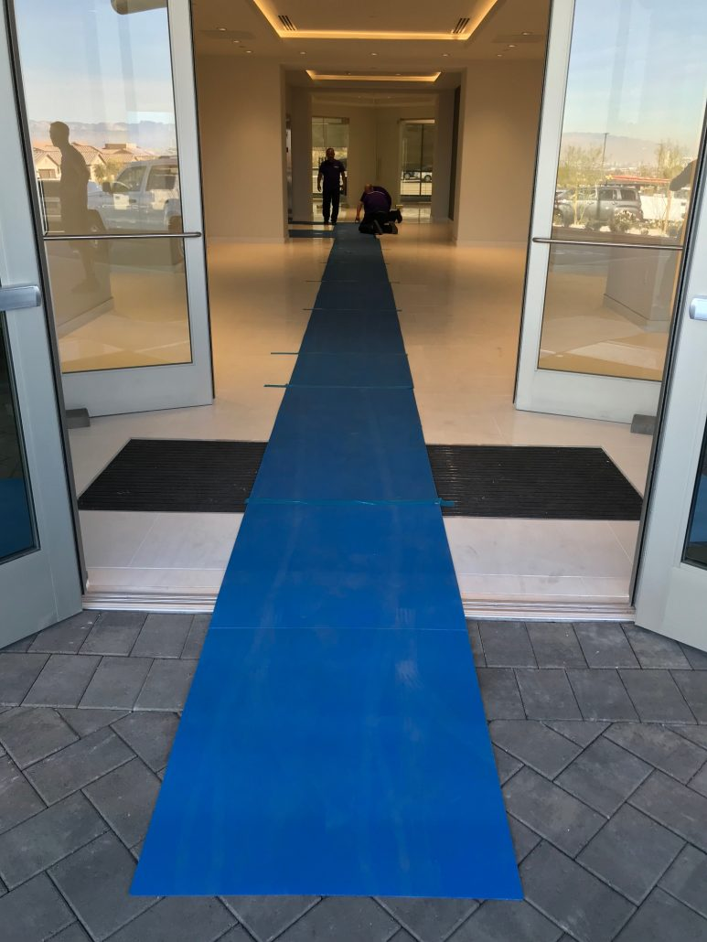 Move 4 Less business move blue carpet to protect floors in new building