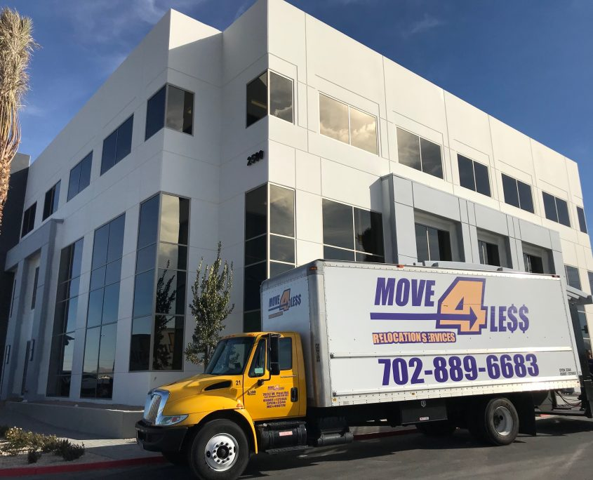 Las Vegas business mover truck Move 4 Less outside a customer's two story office building during a commercial move