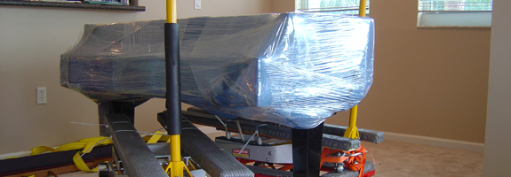 Piano packed with plastic wrap and ready for move