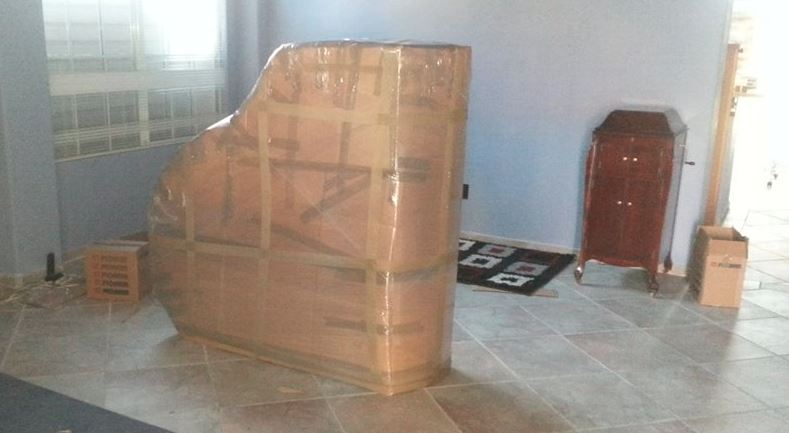 piano packed and ready for a move