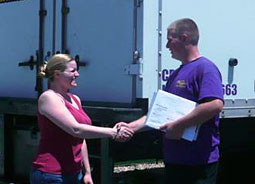 Satisfied customer shaking hands with Move 4 Less Moving supervisor