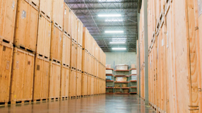 Warehouse logistics - rows of crates being stored